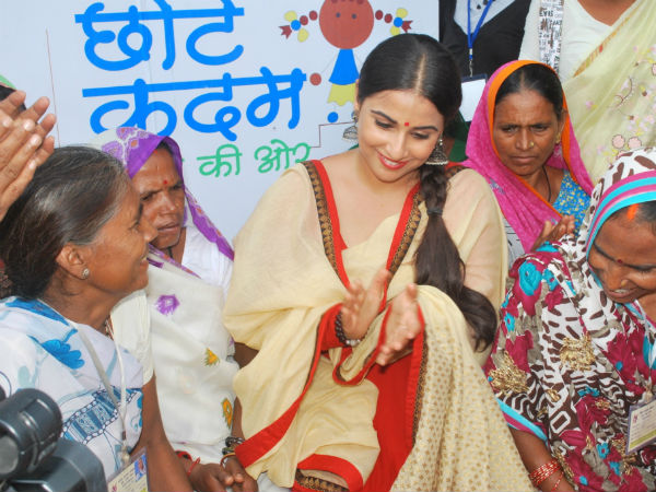Vidya encouraging the self help group women to continue their work on education