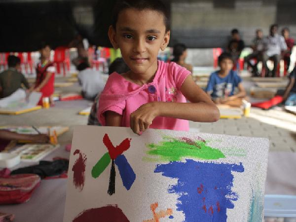 A child with his painting at Kochi Muziris Biennale