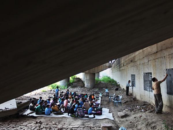 A School Under A Railway Bridge. A Free School for Poor Children