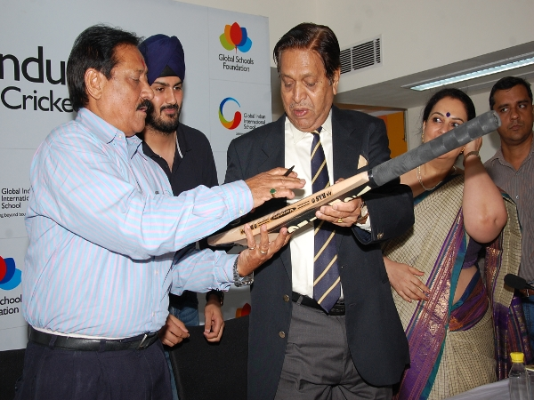 Mr. Chandu Borde & Mr. Chetan Chauhan Signing the Cricket Bat