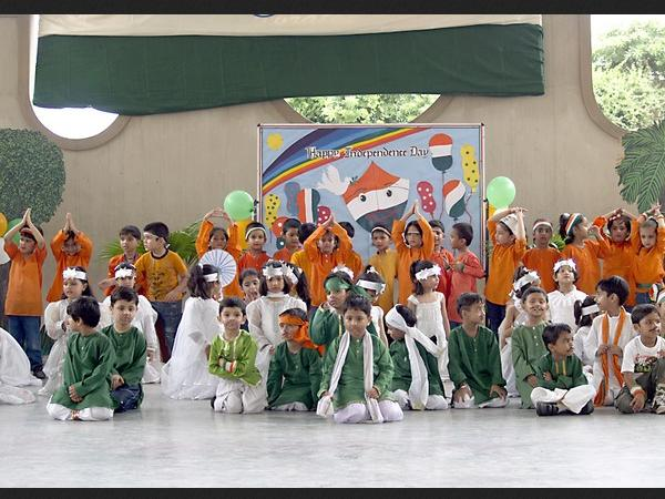 Children perform dance in tri-colour