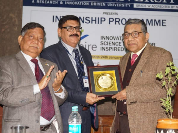 Dr Rajnikant Tiwari receiving memento during the occasion