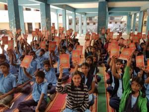 Govt school students receiving school kits